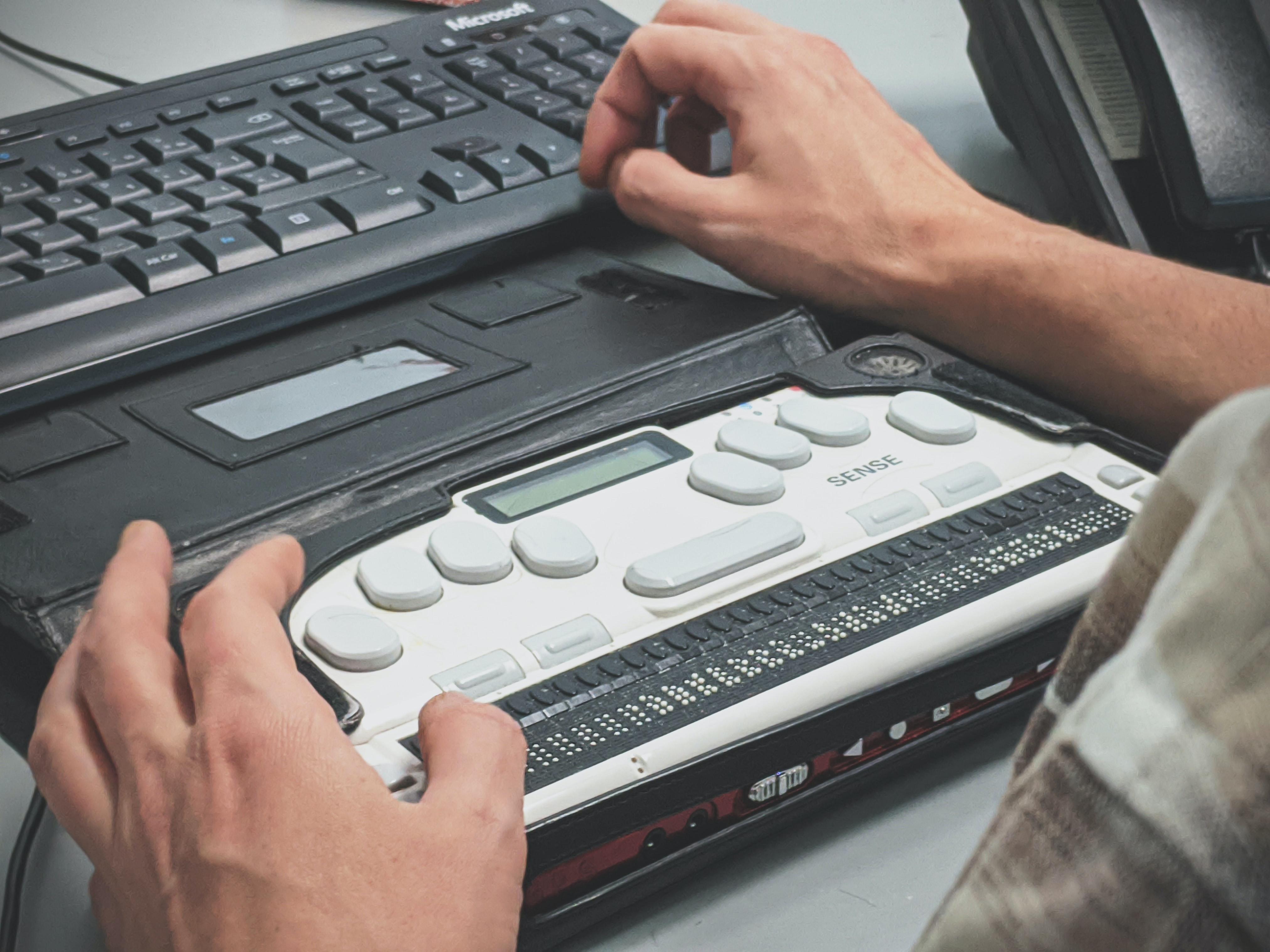 Blind man using a braille screen reader